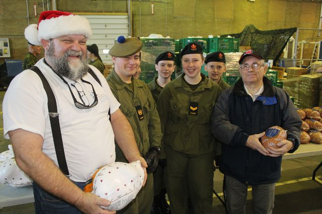 <p>It was distribution day the Cornwall Armoury, for the Children's Christmas Fund. With members of the 2403 Army Cadets SD&G Highlanders are Terry Muir (left, director with the CCF), holding a turkey, and Peter Morgan (right, CCF chairman), with a ham. Photo on Wednesday, December 20, 2017, in Cornwall, Ont.</p><p> Todd Hambleton/Cornwall Standard-Freeholder/Postmedia Network