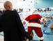 Cochrane's Mayor Jeff Genung feigns helping Santa Claus into the pool but decided against during the Cochrane Comets' first ever swim meet Dec. 16/17.  Santa, the mayor and Blake Richards threw Stampeders footballs to the swimmers.