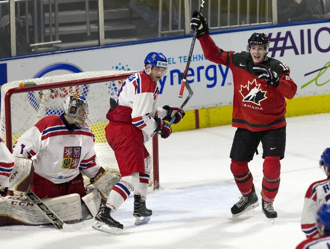 Team Canada's Taylor Raddysh celebrates his team's fourth goal in front of Team Czech Republic's Radim Salda and goalie Jakub Skarek during the second period of their World Junior Championship pre-tournament game with Team Canada at Budweiser Gardens in London. (Derek Ruttan/The London Free Press)
