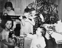 Photo supplied The Levesque family in 1962, on Christmas morning around the traditional, freshly-cut tree. Jocelyne is on the left holding a toy monkey that she had just taken from her baby brother Ed. Sue is behind her, holding her new doll. Frank is examining his new pop-cork gun and Andre is aiming his new BB-gun. Missing is Laura who got a camera that Christmas and took the picture. Melanie, the youngest was not born as yet.