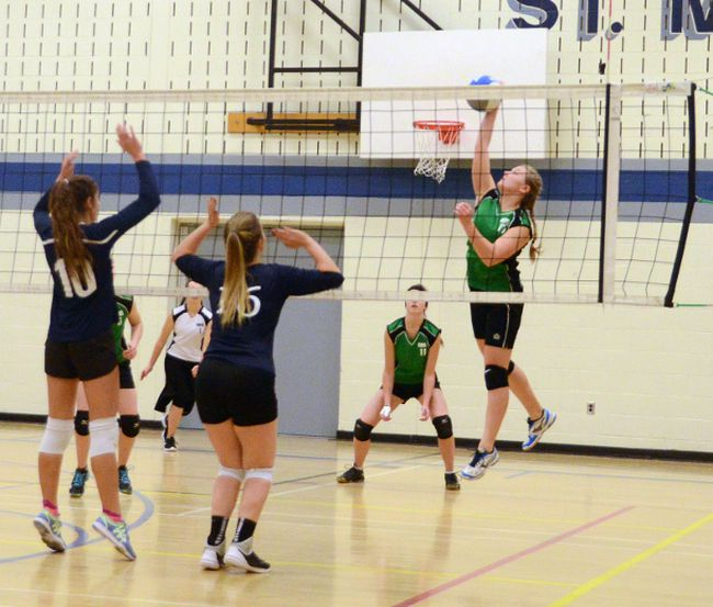 Mariah Shafer spikes a point for the Lions during Grey Highlands  straight-set victory over the Mustangs at St. Mary's in Owen Sound on Wednesday.
