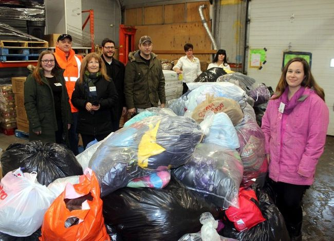 Sean Chase/Daily Observer Renfrew County Child Poverty Action Network (CPAN)'s Operation Snowsuit has received a massive pre-Christmas delivery courtesy of Bell Aliant. Pembroke Giant Tiger once more served as a warehouse for the operation. In the photo (left to right) are CPAN volunteer Brittany Lemaire, Bell technician Trevor Phanenhour, CPAN volunteer Debby Lemaire, Bell technician Marshall Sarr, Bell technician Chad Brand, Giant Tiger manager Paula Young, Giant Tiger manager Connie Cliche and CPAN administration assistant Michelle Rowe. Missing is Bell Aliant snowsuit co-ordinator Jay Pinkham.