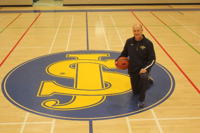 St. Joseph's high school basketball coach Richard Mommersteeg was honoured recently when the school he's worked at for more than 30 years dedicated the basketball court in his name. The court, now known as Mommersteeg Court, is a testament to the man's commitment to his students and school. (Laura Broadley/Times-Journal)