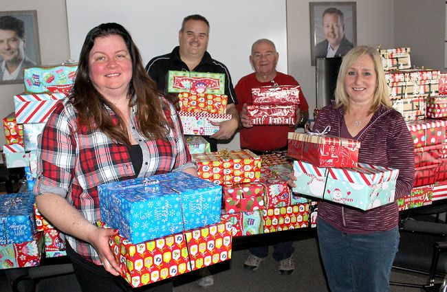 Unifor Local 127 members, from left, Nicole Grainger, Kevin Carey, Bill Zilio and Cathy Baker-Wiebenga, display some of the 100 shoeboxes filled with personal items that the union is donating to people with no permanent address to help make their Christmas a little merrier. Photo taken in Chatham, Ont. on Thursday December 21, 2017. (Ellwood Shreve/Chatham Daily News)