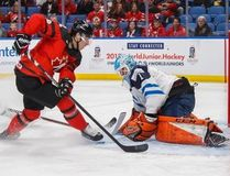 Greyhound and Team Canada member Boris Katchouk breaks in on Finland.