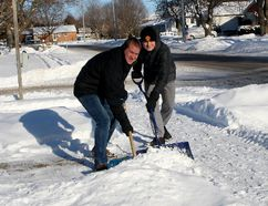 Chatham, Ont. residents Jason King, left, and his son Sawyer King, 17, are among the volunteer snow angels across the region who shovel driveways and sidewalks for the elderly and other people who can't do it themselves. They are seen here on Wednesday December 27, 2017 shoveling the driveway of a home in south Chatham, Ont. (Ellwood Shreve/Chatham Daily News/Postmedia Network)