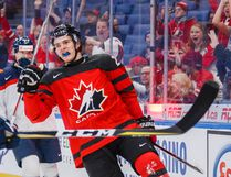 Canada's Sam Steel celebrates after scoring on Slovakia goalie David Hrenak during the first period of their preliminary round game at the world junior championship in Buffalo on Wednesday night. (The Canadian Press)