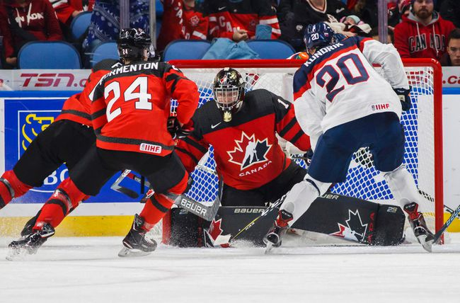 Colton Point guards the net against Slovakia's Peter Kundrik as Canada's Alex Formenton follows during the first period of IIHF World Junior Championship preliminary round hockey action in Buffalo, N.Y. Wednesday. Mark Blinch / The Canadian Press