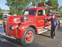 PHOTO COURTESY OF DANA ZIELKE. Oliver Perry stands by the restored Ford three ton 1947 fire truck that was restored as part of the Project 47 initiative.