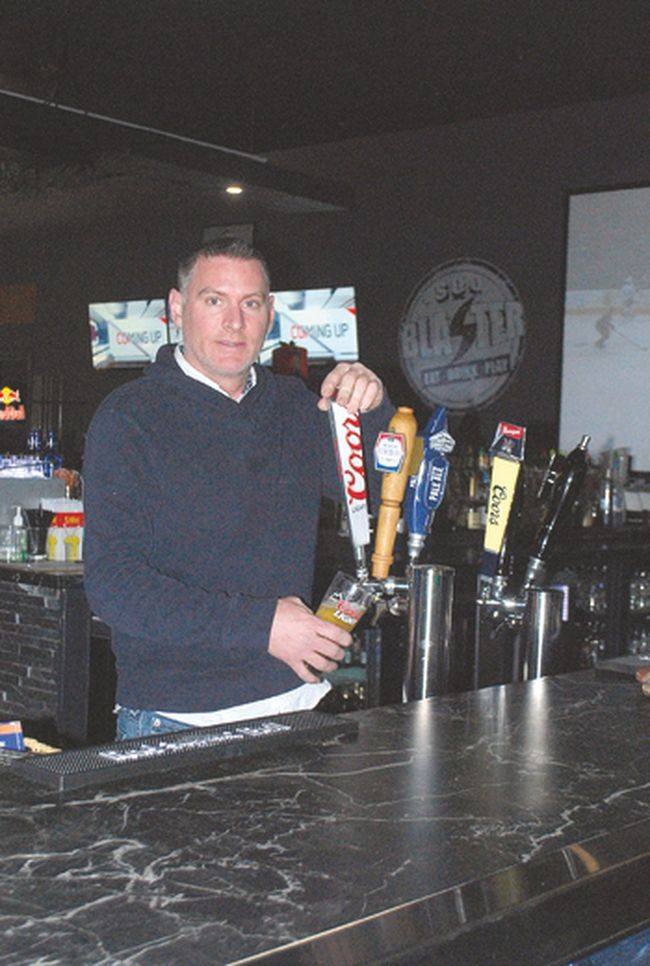 "Eric Nielsen manager at Soo Blasters works the bar. Owner Das Kumar believes his new, ""for-all-ages"" entertainment centre is the largest in Northern Ontario."