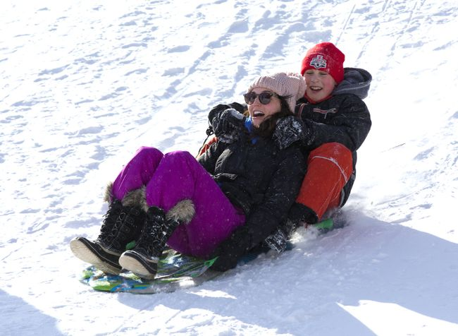 Asha Rogers and her nine-year-old stepson Gavin McIlwain speed down a snow covered hill in Basil Grover Park in London. (DEREK RUTTAN, The London Free Press)