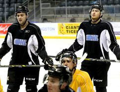 Sean Day, left, and Kingston native Gabe Vilardi at practice with the Kingston Frontenacs at the Rogers K-Rock Centre in Kingston. Both were acquired in a big recent trade with the Windsor Spitfires. (Ian MacAlpine/The Whig-Standard)