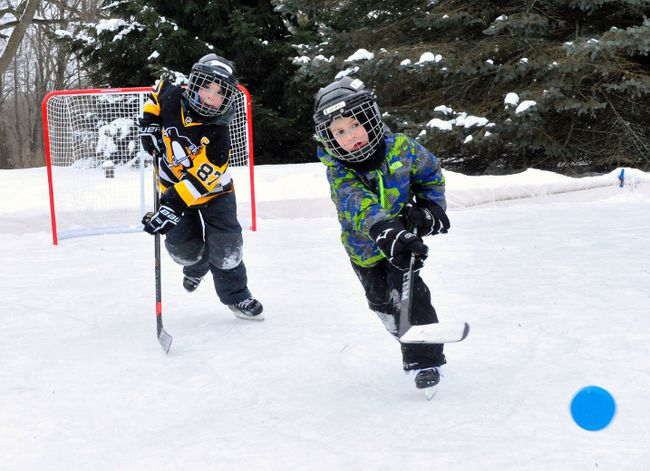 Local youngsters Jacob Laporte and Luke Stefan, both 7, enjoy a game of shinny at the Stefan residence on Fertilizer Road in Delhi on Wednesday. Area residents have taken advantage of abnormally cold temperatures to build outdoor rinks of all shapes and sizes in Norfolk this winter. JACOB ROBINSON/Simcoe Reformer