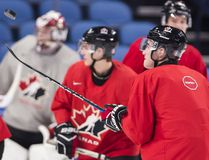 Canada captain Dillon Dube (9) flips the puck around during practice ahead of the upcoming semi-final IIHF World Junior Championships, against the Czech Republic in Buffalo, N.Y., on Wednesday, January 3, 2018. (THE CANADIAN PRESS)