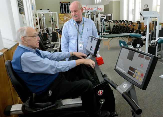Dr. Larry Patrick, right, talks with patient Bill Brady at the Cardiac Fitness Institute at the London Health Sciences Centre on Wednesday January 3, 2018. (MORRIS LAMONT, The London Free Press)