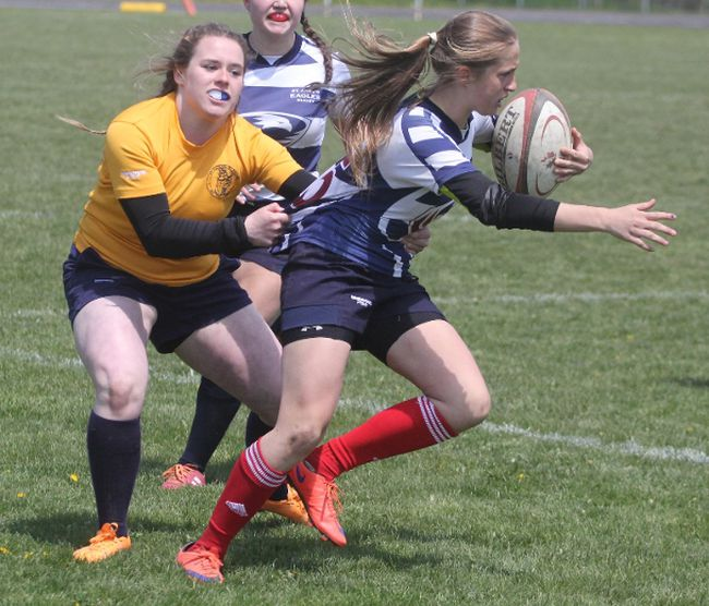 St. Michael's Sarah Bailey takes down a St. Anne's player during the Huron-Perth varsity girls rugby final in May. (CORY SMITH, Beacon Herald)