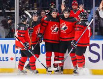 Canada's Jonah Gadjovich, second right, celebrates his goal with teammates Michael McLeod, centre, Cale Makar, right, Tyler Steenbergen, second left, and Victor Mete against Slovakia during the second period of IIHF World Junior Championship preliminary round hockey action in Buffalo, N.Y. Wednesday December 27, 2017. THE CANADIAN PRESS