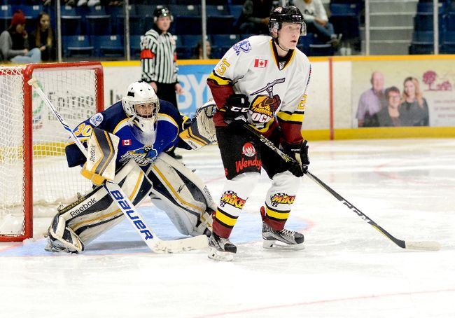 Rock fans anxiously awaiting the return of forward Stewart Parnell, shown here positioned in front of Gold Miners goalie Cade McEwen during an NOJHL game at the Joe Mavrinac Community Complex on Sept. 29, can take some comfort from the fact he may be back before the end of the month. Parnell definitely won't be in the action when the Rock travel to Kirkland Lake Saturday night and then host the Hearst Lumberjacks at the McIntyre Arena Sunday evening.  THOMAS PERRY/THE DAILY PRESS