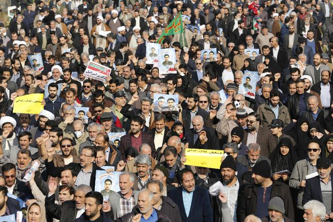 Iranian pro-government protesters take part in a march held after the weekly Friday prayers in central Tehran on January 5, 2018.