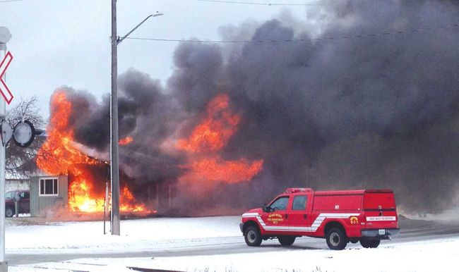 A fire burns at a four-unit complex on Nadon Street in Blind River in December 2014. (Postmedia File Photo)