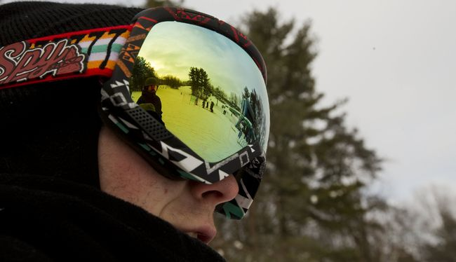 Reid Hensen's ski goggles reflect the hill and lift at Boler Mountain in London on Tuesday. Boler has had a banner start to the season with a new $6-million chalet keeping people on the property longer and in comfort. (MIKE HENSEN, The London Free Press)