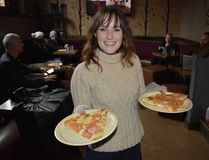 Cat Ring gets ready to serve New Haven thin-crust style pizza at Piece Brewery and Pizzeria, one of the stops on the 3-1-Chew food tour in Chicago's Bucktown and Wicker Park neighbourhoods. Thin crust outsells deep dish in Chicago, Ring says. (WAYNE NEWTON, Special to The London Free Press)