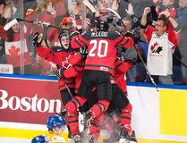 Canada players celebrate forward Tyler Steenbergen's goal against Sweden during the third period of the gold-medal game at the IIHF World Junior Championship in Buffalo, N.Y. on Friday, January 5, 2018. (THE CANADIAN PRESS/Frank Gunn)