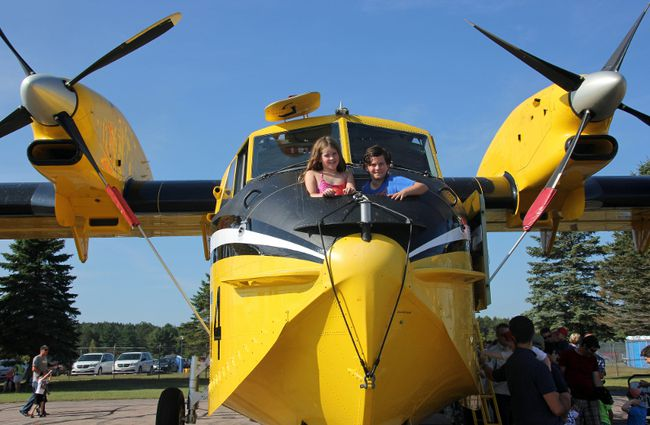 On Sept. 23, siblings Kierra and Ellis Shields sat in the front of a CL-415 water bomber which was on display at the Pembroke and Area Aiport  Saturday as part of the Canada 150 Fly-in event.