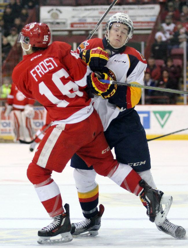 Erie Otters defenceman Jordan Sambrook and Soo Greyhounds centre Morgan Frost collide during OHL action at Essar Centre. The two are now teammates after the Hounds acquired Sambrook, along with Taylor Raddysh, on Saturday. JEFFREY OUGLER/SAULT STAR