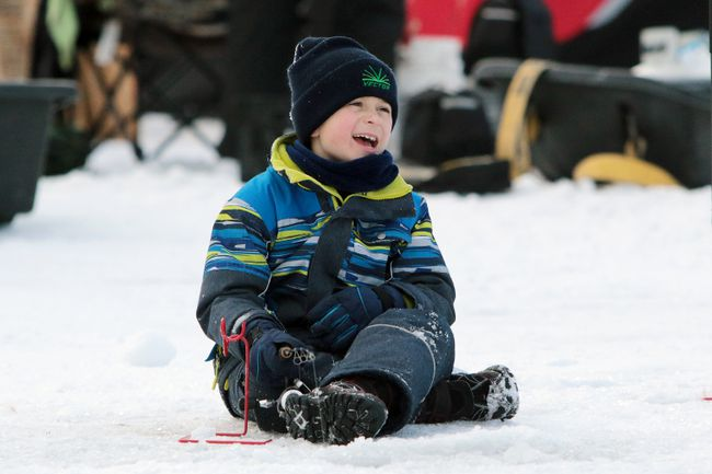 Seven-year-old Carson Cunningham is all smiles while fishing at the fourth annual KidFish Ice Derby on the Red River north of Selkirk, Man., on Sunday, Jan. 7, 2018. (Brook Jones/Selkirk Journal/Postmedia Network)