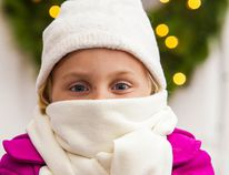 Ensure you have the proper warm clothing before heading outside, as well as an emergency kit in the vehicle and a fully-charged cell phone (Metro Creative Graphics).