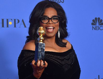 Actress and TV talk show host Oprah Winfrey poses with the Cecil B. DeMille Award during the 75th Golden Globe Awards on January 7, 2018, in Beverly Hills.
