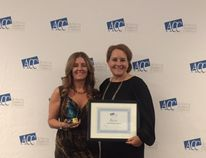 Sherri Bohme, executive director of the Cold Lake Chamber of Commerce, accepts the Chamber of the Year award from Shauna Miller, an Alberta Chambers of Commerce executive committee member.
