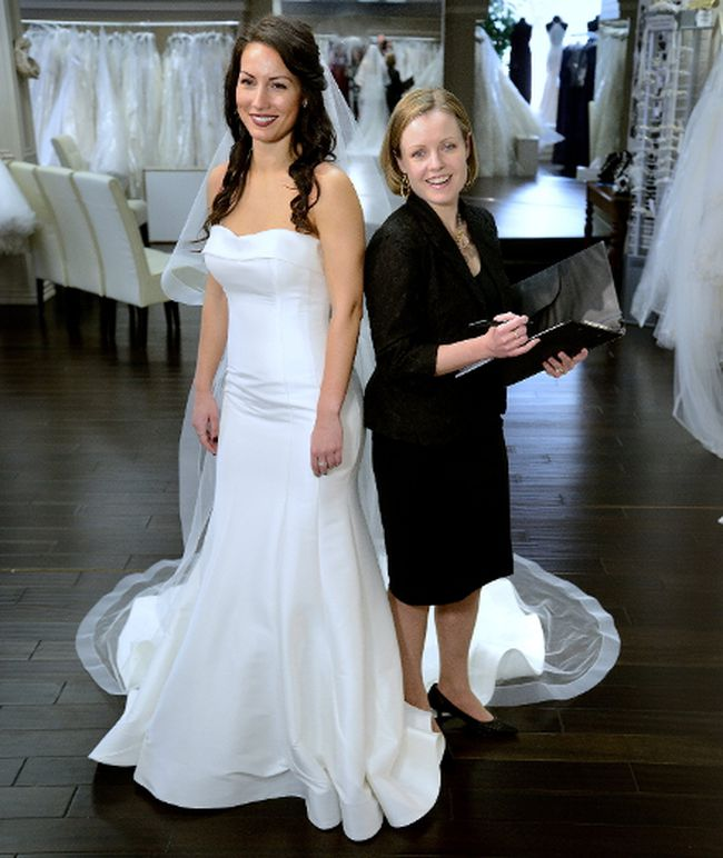 Model Kori Marques wears a fitted, strapless silk Mikado gown by Allure for $1,325. She is also wearing a cathedral length veil by Allin Rae for $375. With her is wedding planner Amy McNall, on location at Sophie's Gown Shoppe. (MORRIS LAMONT, The London Free Press)