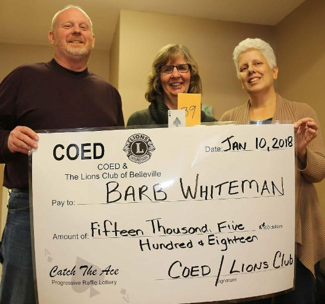 TIM MEEKS/THE INTELLIGENCER Barb Whiteman of Belleville, centre, accepts the winning grand prize of $15,518 from the Catch the Ace Belleville progressive raffle from Belleville Lions Club member Dan Collins and Margaret Goyette, community development worker for Continuing On In Education, Wednesday. COED and the Lions Club will run Catch the Ace again this year and are hoping to start the weekly raffle in February.