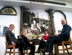 Nancy Collister, the London Public Library's director of customer services and branch operations (left), Dorothy Palmer and Sharon Lunau from ACO London, and Mike Baker, formerly of Museum London, sit next to the Marshall Bros. and Co. façade recently installed at the Central Library downtown. (CHRIS MONTANINI, Londoner)