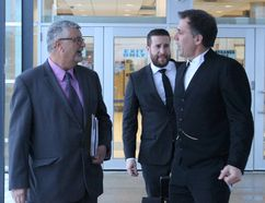 Former Sarnia fire chief Patrick Cayen, left, and his defence lawyer Phillip Millar leave the Sarnia courthouse following the first day of his second trial on sex charges. His conviction was overturned by Ontario's court of appeal. (NEIL BOWEN/Sarnia Observer)