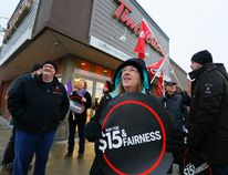 Protesters gather outside the Tim Hortons store on Monaghan Rd. on Wednesday January 10, 2018 in Peterborough, Ont. demanding that the corporation not roll back workers' wages and benefits. When Ontario's minimum wage increased to $14, many Tim Hortons stores immediately began to eliminate workers' paid breaks, reduce access to basic drug and dental benefits, eliminate uniform and drink allowances, and even cut employees' hours of work. CLIFFORD SKARSTEDT/PETERBOROUGH EXAMINER