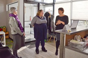 Saffron executive director Katie Kitschke (right) talked about the new enhancements of Saffron's new facility to Health Minister Sarah Hoffman (middle) and Sherwood Park MLA Annie McKitrick during an open house in February.