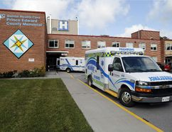 Luke Hendry/The Intelligencer Ambulances wait outside Prince Edward County Memorial Hospital in Picton. The South East Local Health Integration Network board is expected later this month to approve the first phase of the plan to build a new hospital behind the existing one.
