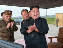 In this undated file photo distributed on Saturday, Sept. 16, 2017, by the North Korean government, North Korean leader Kim Jong Un, center, celebrates what was said to be the test launch of an intermediate range Hwasong-12 missile at an undisclosed location in North Korea. Korean Central News Agency / Korea News Service via AP