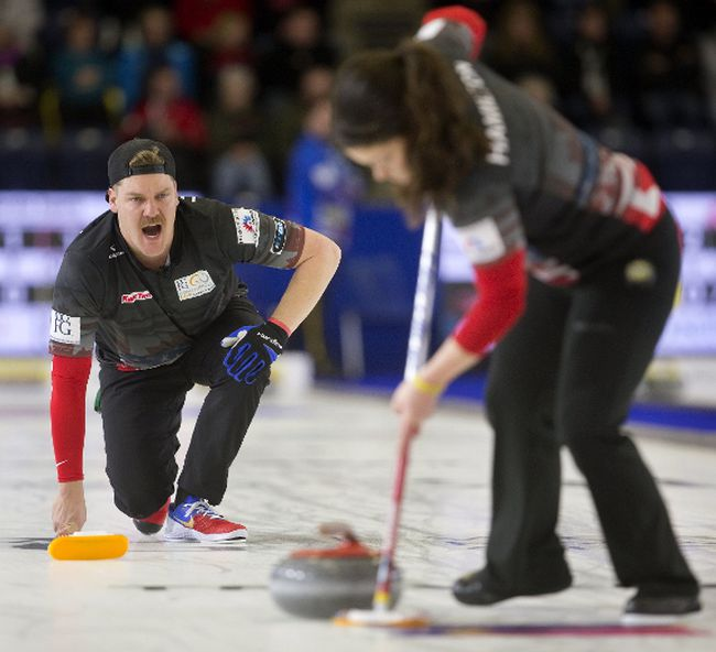 Becca Hamilton sweeps for her brother Matt Hamilton as they play mixed doubles against Sofia Mabergs and Niklas Edin at the Continental Cup at the Western Fair Sports Centre on Thursday. (MIKE HENSEN, The London Free Press)