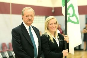 In this file 2010 photo Michel Dupuis, one of the creators of the Franco-Ontarian flag, is seen with his daughter, Natalie. Dupuis died Thursday at the age of 62.