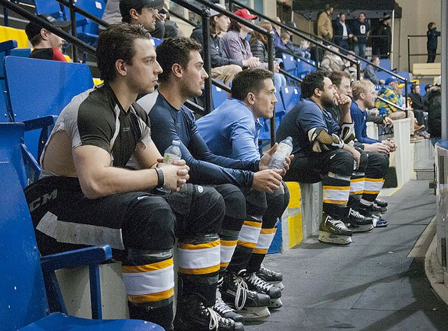Without enough time to change between games 3HLTOUR players often sit and watch with the fans, Theo Peckham - pictured fourth from the left - captains the Guelph Brewers and will be among a handful of former Owen Sound Attack players competing Saturday at the Bayshore. FILE PHOTO.
