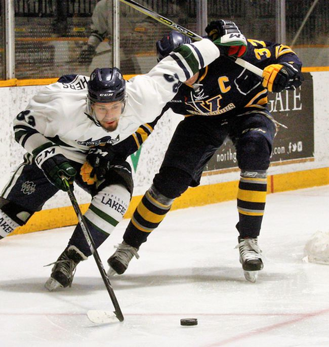 Danny Desrochers, left, scored the lone goal for the Nipissing Lakers as the men's hockey team was edged 2-1 by the visiting Laurentian Voyageurs at Memorial Gardens, Saturday. Nipissing hosts the Ottawa Gee Gees, tonight, and Carleton Ravens, Saturday, as they try to gain some ground in the OUA East Division. The Lakers are tied for eighth place with RMC but has one game in hand. Dave Dale / The Nugget
