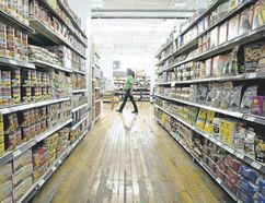 "An employee walks past an aisle filled with food items at the Old East Village Grocer, a social enterprise on Dundas Street in London. An intriguing mixture of a grocery store and a skills-training centre, the establishment is ""exactly the kind of opportunity other municipalities around the world are maximizing,"" writes columnist Glen Pearson. (London Free Press file photo)"