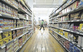 An employee walks past an aisle filled with food items at the Old East Village Grocer, a social enterprise on Dundas Street in London. An intriguing mixture of a grocery store and a skills-training centre, the establishment is ?exactly the kind of opportunity other municipalities around the world are maximizing,? writes columnist Glen Pearson. (London Free Press file photo)