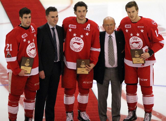 Sault Ste. Marie Greyhounds who were members of Team Canada, which captured gold at the 2018 IIHF World Junior Hockey championship, are honoured Wednesday, Jan. 10, 2018 prior to play against the Saginaw Spirit at Essar Centre in Sault Ste. Marie, Ont. Conor Timmins (left to right), Hounds general manager Kyle Rafts, Boris Katchouk, Greyhounds governor George Shunock and Taylor Raddysh, partake in a pre-game ceremony at centre ice. Raddysh was recential traded to the Hounds from the Erie Otters. JEFFREY OUGLER/THE SAULT STAR/POSTMEDIA NETWORK