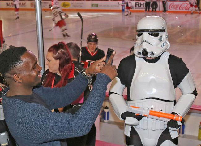 TIM MEEKS/THE INTELLIGENCERSenators fans were grabbing lots of photos and selfies of the Stormtroopers and other characters at Star Wars Night.