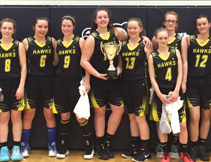 The J.C. Charyk senior girls basketball team pose for a team photo after championing a tournament in Cold Lake on Saturday. Supplied